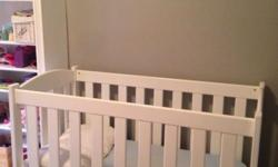 White solid wood baby cot for sale. In great condition.