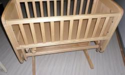 Attractive wooden baby rocker,  Immaculate condition,