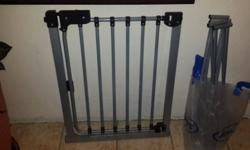 1.22m safety gate with extensions. 1 x grey. 1 x white.