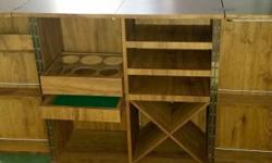 Oak veneer whisky cabinet on castors converting to bar