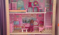 Fully furnished Barbie doll house in excellent