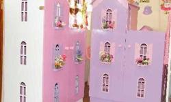 Pretty dollhouses Barbie Sized with sturdy doors. Made