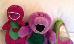 A singing Barney,a Barney back pack with zip-opens like