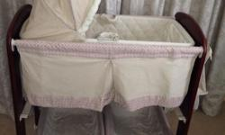 Bassinet with changing table and storage - Like new -