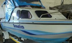 Bay Cruiser 575 on trailer and sun canopy with sides
