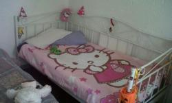 Beautiful white steel frame bed with patterns on, in