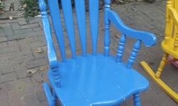 Solid wooden chair painted bright blue. Absolutely