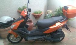 lovely condition.tyres like new.low kms.comes with top