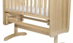 The smooth gliding action of this crib will sooth and