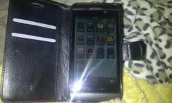 Black Blackberry Z10 with cell phone case. In good