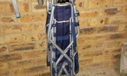 Easy foldable stroller with shade and safely front bar,