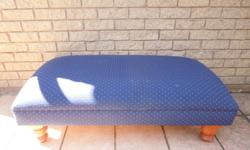 This beautiful upholstered blue ottoman is perfect for
