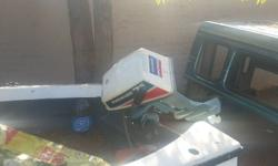 Boat and trailer for sale with motor (Evinrude 7.5) in