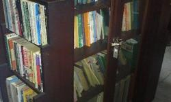 the large bookcase is in pristine condition with two