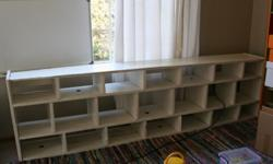 Newly painted white shelf for books/toys/educational