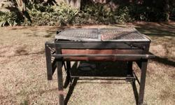 Large fold out steel braai with stainless steel trays.