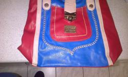I'm selling a brand new red and blue guess handbag,