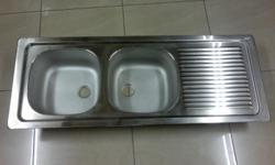Brand new kitchen sink with a double bowl and drainer.