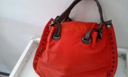 This Fire engine red color hand bag is very sizzling