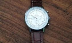 Breitling mens watch - R300. Brand new. It has a brown