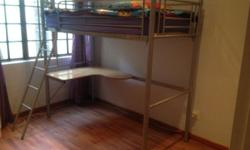 Bunk bed with wooden desk incl mattress. Steel frame on
