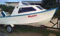 Cabin boat on trailer with 65hp Chrysler motor motor is