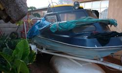 cabin cruiser boat with 55 hp yamaha motor and sun