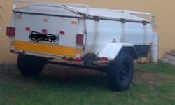 Caddy trailer with spare wheel and paperwork in order -