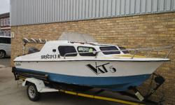 Calibre cabin with 60Hp mariner on trailer with