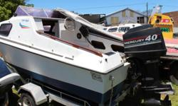 Calibre with 40hp Mercury motor, manual start and