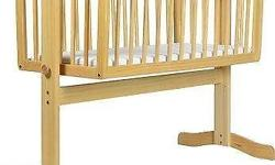 Traditional style swinging crib to gently rock baby to