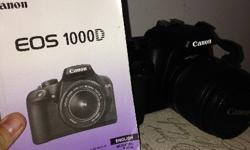 I am selling my 1000D camera (with carry bag,