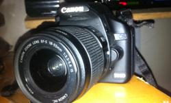 I M SELLING MY CANON 500D WITH CHARGER IN GOOD