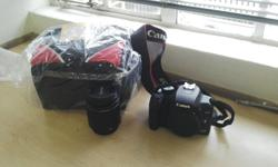 selling a EOS 1000D canon camera with Brand new