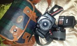 Camera for sale with original bag, flash and lenses.
