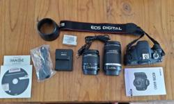 1. Canon EOS 600D camera with 2 lenses 2. 1) EFS