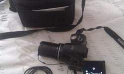 Camera + 8 GB card + Lowepro travel bag for sale! Well