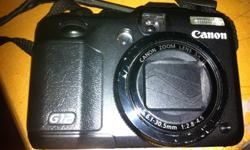 I M SELLING MY CANON G12 IN VERY GOOD CONDITION FOR