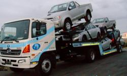 Beskrywing We specialize in vehicle transportation
