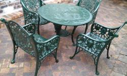 Beautiful cast iron garden or patio set consisting of