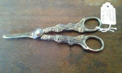 Antique pair of scissors with the most beautiful flower