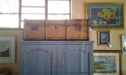 Antique wooden trunk that is just old, worn, rugged and