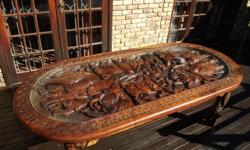 Big Five Carved Wild Teak dinner table with glass top