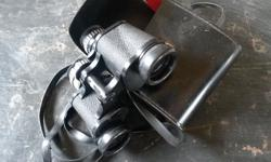 Black binoculars in a case Our shop is situated in