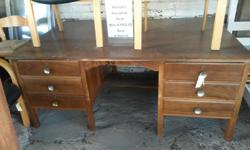 Large executive wooden desk with six massive draws.