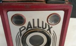 Vintage Pallux Box Camera in red.