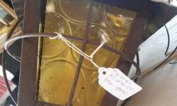 Rustic Lantern with yellow glass that is ready for the