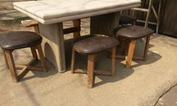 Four wooden stools that fit around a table and are