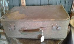 Vintage Material Suitcase that is sold old that the