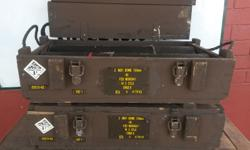 Vintage wooden ammo boxes with the containers for the